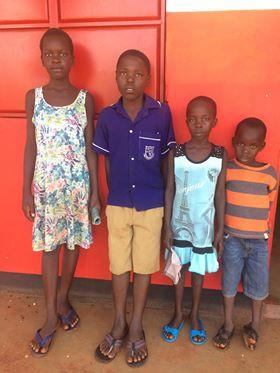 Shubie, Sharif, Angel and Jordan waiting to take their pre-exams for school.