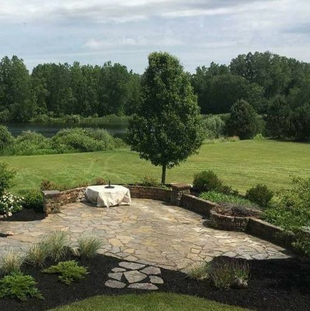 Flagstone Patio With Seat Walls, Pillars and Built In Firepit