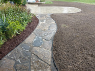 Flagstone Walkway Leading To a New Brick Paver Patio
