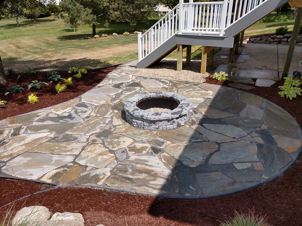 Flagstone Patio and Fire Pit With Landscape Plantings