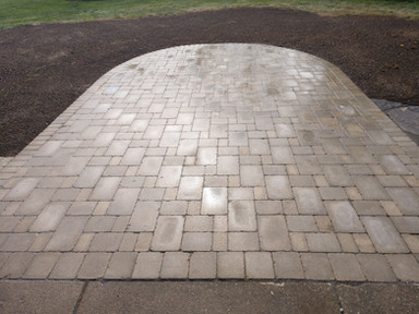 Add Warmth To Your Back Yard With A Brick Patio