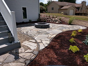 From boulder retaining walls to flagstone patios, All Terra Landscape Services can design it