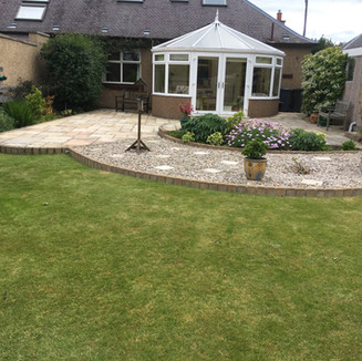 Client wanted larger seating area which was to wrap around their new conservatory