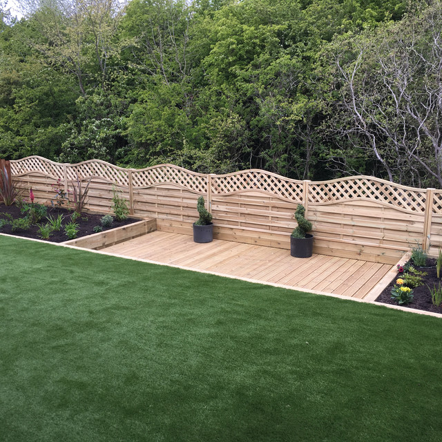 New build property had a severe gradient. We raised the levels and installed artificial grass with raised decked terrace with planters