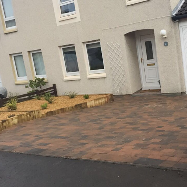 The old garden was removed and a new driveway with vertical sleepers as retainers with gravel and shrubs