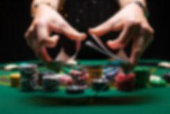 Girl dealer or croupier shuffles poker c
