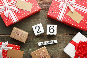 Boxing Day Concept. Different kinds of gift boxes on wooden background.jpg