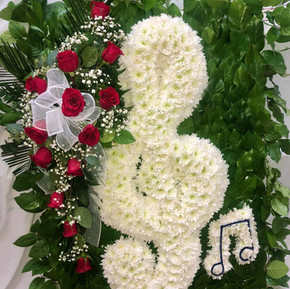 Musical note with red rose arrangement