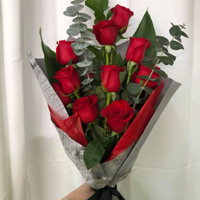 Red roses & eucalyptus branches