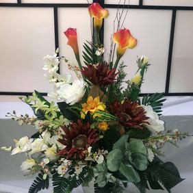 Burgundy artificial flower arrangement