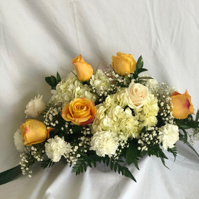 Gold centerpiece with roses, hydrangeas and carnations