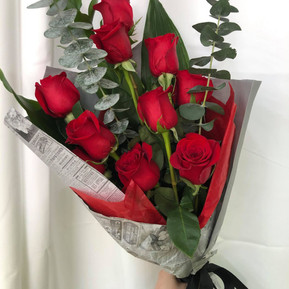 10 Red Roses with deluxe newspaper wrapping