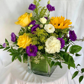 Sunflowers, yellow roses & purple lisanthius'