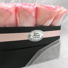 Dozen pink roses in black square box