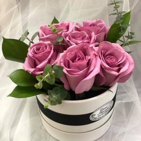 Half dozen lilac roses in white round box