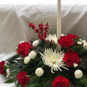 Traditional Christmas centerpiece with white candle