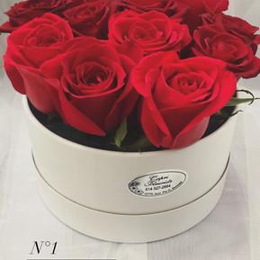 N1. A dozen roses in white black round box
