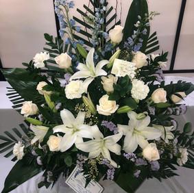Violet & white potted arrangement