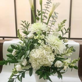 Modern white potted arrangement