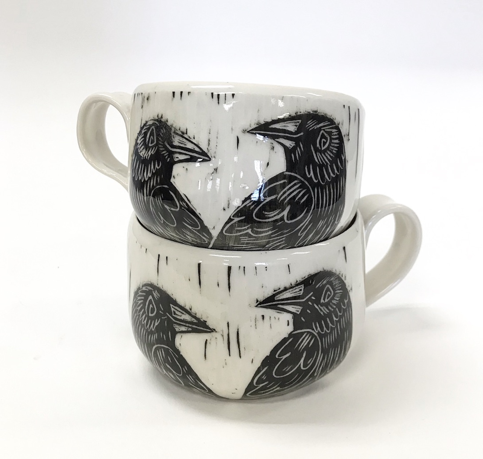 raven mugs stacked
