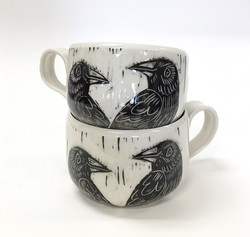 raven mugs stacked