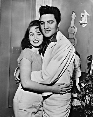 dec 27 57 Elvis Presley hugging Kathy Ga