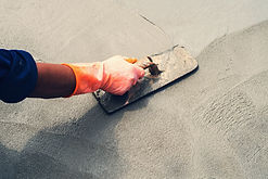 close-up-hand-worker-leveling-concrete-p