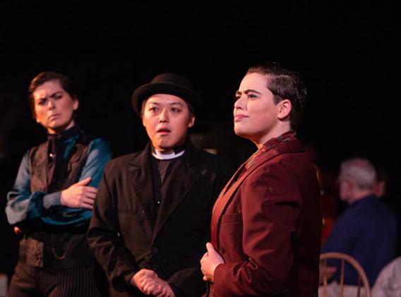 Anna-Constantia Richardson as John Jasper, Hubert Hwang as Reverend Crisparkle, and Zoe Sheinkopf as Neville Landless