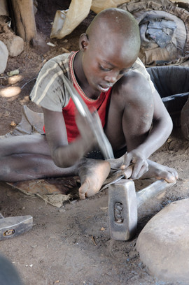 Child working a knife for gathering crops