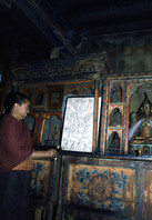 Monk proudly showing artifacts