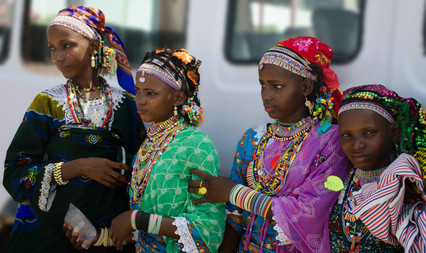 Women dressed up to go to a wedding