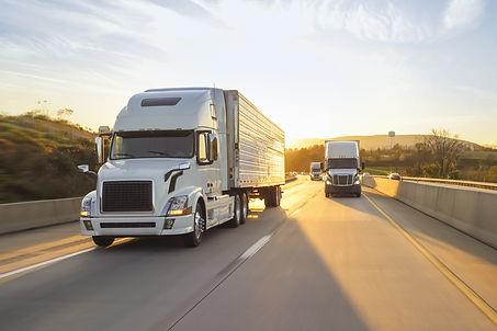 semi-truck-18-wheeler-sunrise-on-highway