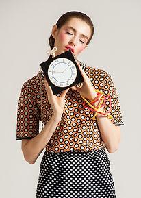 Model Holding Clock