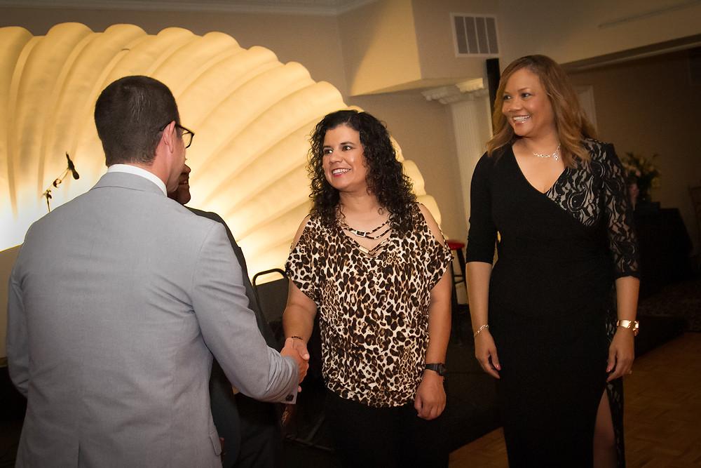 Gina Receiving Her Award at TMI Transforming Lives Gala