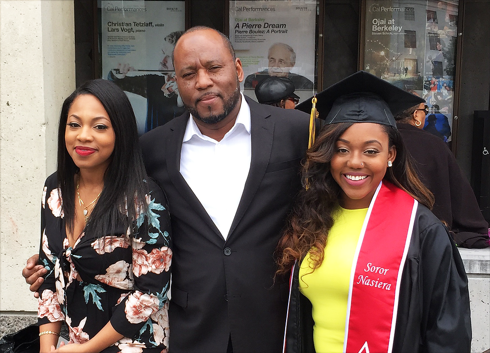 (Marcus with his daughters Aasija and Nasiera at her graduation from UC Berkeley)