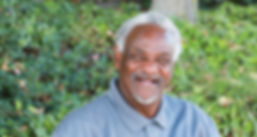 Older man with a disability smiling