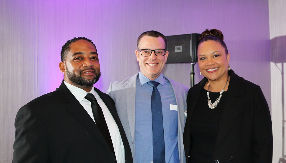 TMI Associate Executive Director Jessie Campbell, Board Chair Bryan Shull and Executive Director Rachel Harris