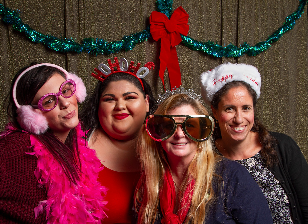 Carleigh, Bridget, TMI Manager Julie Dickerson and Andrea at the TMI 2019 Holiday Party
