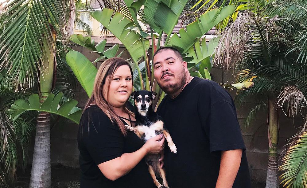 Corina with her husband Adam and their dog Champ