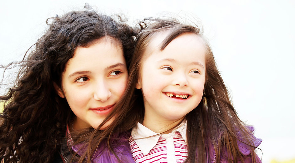 Young girl with Down syndrome with her sister