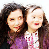 Girl with Down syndrome and her sister