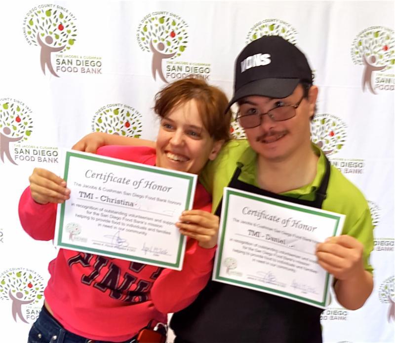 Christina and Daniel receiving their awards