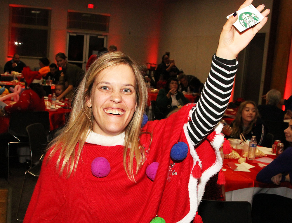 Christina was excited to receive her gift at the TMI Holiday Party.