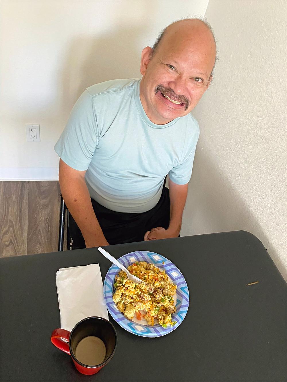 David happily preparing to enjoy his delicious meal