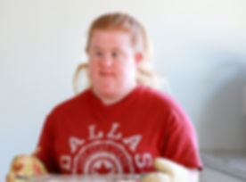 Woman with Down syndrome baking