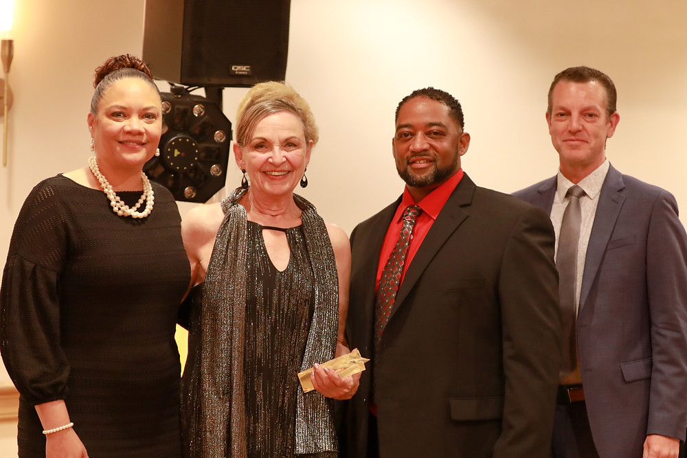 (TMI Executive Director Rachel Harris, Jacquelynn Webster-Anderson, TMI Associate Executive Director Jessie Campbell, and TMI Board President Bryan Shull)