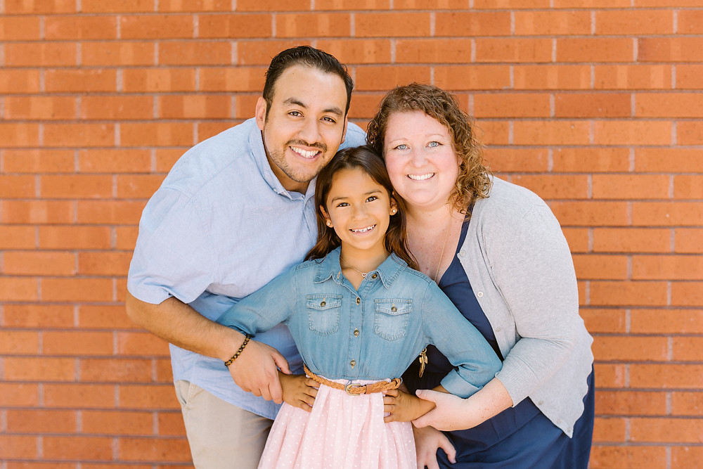 Melinda with her husband and middle daughter.