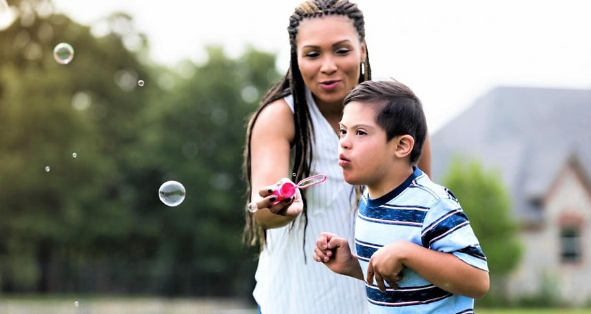 Mom and son bubbles special needs istock.jpg