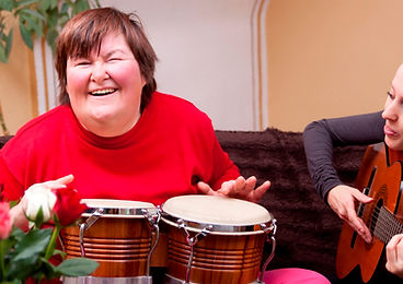 Woman with Down Syndrome Playing Music