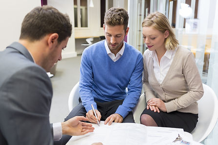 Young couple meeting real-estate agent f